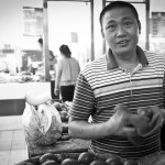 Man Polishing Tomatoes